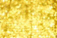 Bokeh gouden onduidelijk beeld Gouden schitterende lichten De cirkels van Bokeh stock foto