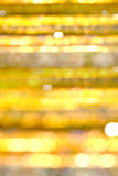 Bokeh guld- dekoreringbakgrund Arkivfoto