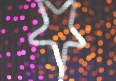 Bokeh gwiazdy światła ultrafioletowy i pomarańczowy kolor Obrazy Royalty Free