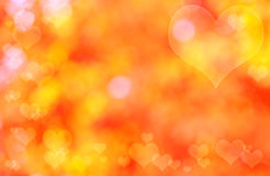 Bokeh hearts background. Abstract orange heart bokeh background stock photo