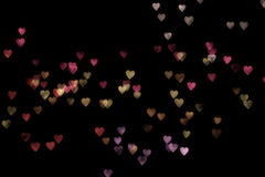 Bokeh hearts. A background of colorful bokeh hearts stock photography