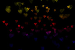 Bokeh hearts. Colorful bokeh hearts on a black background royalty free stock photos