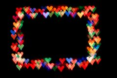 Bokeh hearts isolated on a black background hearts of different colors form the frame royalty free stock photo