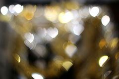 Bokeh hearts sparkling in the background. Royalty Free Stock Photos