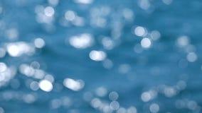 Bokeh-Hintergrund mit Bewegung des Wassers Abschluss oben Langsame Bewegung stock video footage