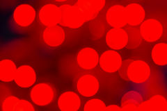 Bokeh Holiday Lights Backgrounds. Abstract circular bokeh background of red Christmas lights Stock Photo