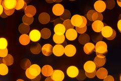 Bokeh Holiday Lights Backgrounds. Abstract circular bokeh background of yellow Christmas lights Royalty Free Stock Photos