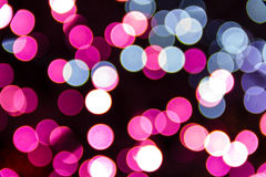 Bokeh Holiday Lights Backgrounds. Abstract circular bokeh background of pink and blue Christmas lights Royalty Free Stock Photos