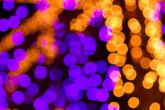 Bokeh Holiday Lights Backgrounds. Abstract circular bokeh background of purple and white Christmas lights Royalty Free Stock Photography