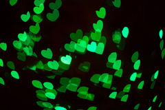 Bokeh Holiday Lights Backgrounds. Abstract heart shaped bokeh background of green Christmas lights Royalty Free Stock Images