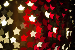 Bokeh Holiday Lights Backgrounds. Abstract heart shaped bokeh background of red and white Christmas lights Stock Photos