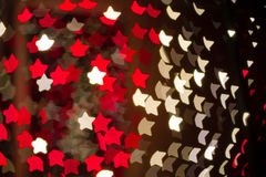 Bokeh Holiday Lights Backgrounds. Abstract star shaped bokeh background of red and white Christmas lights Royalty Free Stock Photos