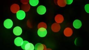 Bokeh ilumina o laço do fundo Partículas moventes Fundo abstrato colorido video estoque