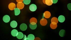 Bokeh ilumina o laço do fundo Partículas moventes Fundo abstrato colorido filme