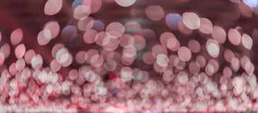 Bokeh ilumina-se, luzes cintilantes do ponto do borrão no fundo abstrato cor-de-rosa Imagens de Stock Royalty Free