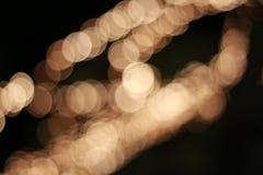 Bokeh léger de fond d'or Image libre de droits