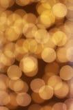 Bokeh léger de fond d'or Images libres de droits