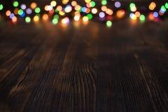 Bokeh léger sur le fond en bois Image stock