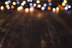 Bokeh léger sur le fond en bois Image libre de droits