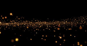 Bokeh ligero de oro de las partículas del brillo de la Navidad loopable en fondo negro almacen de video
