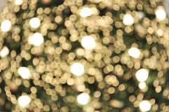 Bokeh light background. Holiday glowing backdrop. Defocused Background With Blinking Stars. stock image