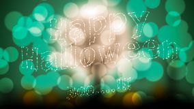 Bokeh light effect and Halloween word Royalty Free Stock Photos