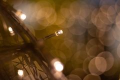 Bokeh of light with long ube of light on the metal net