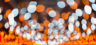 Bokeh light, shimmering blur spot lights on orange abstract background. Royalty Free Stock Photo