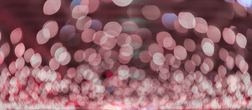 Bokeh light, shimmering blur spot lights on pink abstract background. Royalty Free Stock Images
