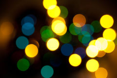 Bokeh lights. Color bokeh lights on dark background Royalty Free Stock Images