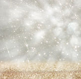Bokeh lights background with colors of white and silver and motion blur Royalty Free Stock Photos