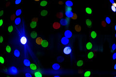 Bokeh lights. Beautiful Christmas background.  and New Year.  light  Festive abstract  with Royalty Free Stock Photography
