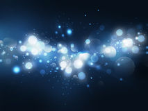 Bokeh lights on blue background Stock Photos