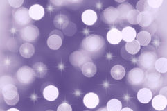 Bokeh Lights. Defocused purple and white bokeh christmas lights Royalty Free Stock Images