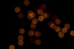 Bokeh lights. Bokeh effect with bulbs. Black background Stock Photography
