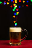 Bokeh lights floating out of a beer glass royalty free stock image