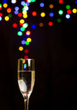 Bokeh lights floating out of a champagne glass Royalty Free Stock Photo