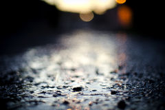 Bokeh lights over wet ground