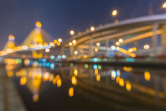 Bokeh lights of Phomipoon Bridge with water reflextion Royalty Free Stock Images