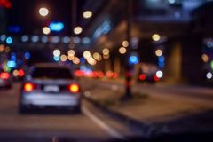 Bokeh lights on road in the city. Night lights in city, street lights bokeh background, blur of night lights bokeh on street Royalty Free Stock Photos
