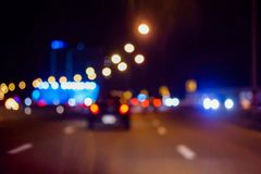 Bokeh lights on road in the city. Night lights in city, street lights bokeh background, blur of night lights bokeh on street Royalty Free Stock Image
