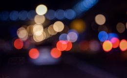 Bokeh lights on road in the city stock illustration