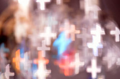 Bokeh lights shaped like crosses Stock Photography