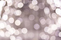 Bokeh from the lights of street illumination. Cool silver white light royalty free stock photos