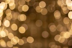 Bokeh from the lights of street illumination. Warm golden yellow light royalty free stock photos
