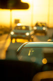 Bokeh lights of traffic during sunset. Royalty Free Stock Images