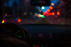 Bokeh lights from traffic on wet day. Night storm raining car driving concept.  stock photos