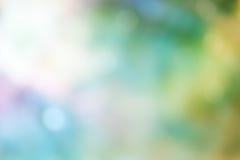 Bokeh ljus på grön bakgrund för pastellfärgad färg Fotografering för Bildbyråer