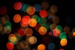 Bokeh - luzes borradas alargamentos da lente Foto de Stock