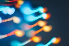 Bokeh mágico de la Navidad de las luces en fondo negro fotos de archivo libres de regalías